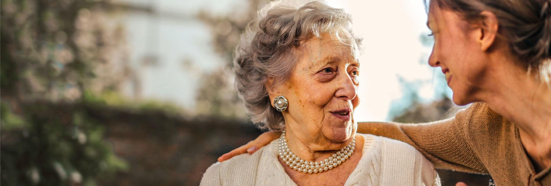 Older woman still lives at home with live-in care and support