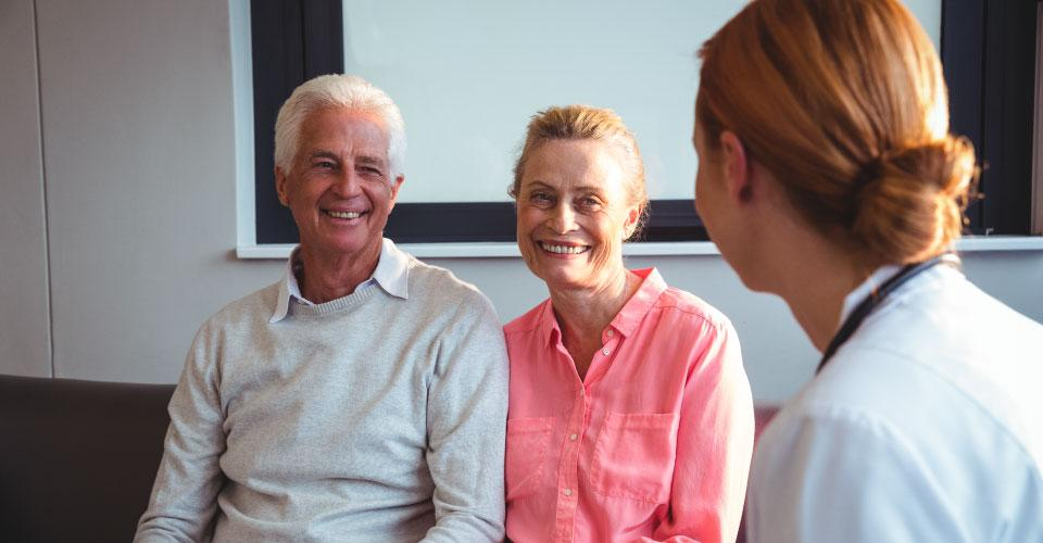 Support worker from Hazelcare Limited discusses respite care with senior couple