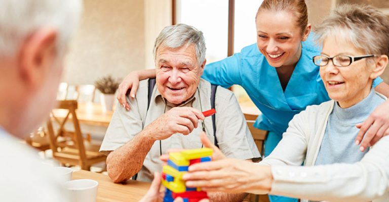 Husband and his wife with specialist carer in the Southwest